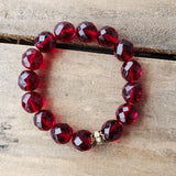 garnet red 12mm Czech beads with vintage details stretch protection bracelet