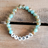 teal tan 6mm beads with letter beads spelling STRONG Message stretch Bracelet