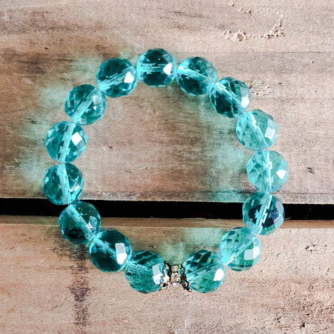 Aquamarine color 12mm Czech beads with vintage details stretch protection bracelet