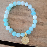 8mm sea blue agate w round gold sunburst charm stretch bracelet
