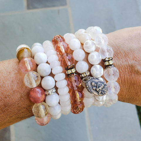 variety of Marinella bead bracelets stacked on wrist