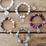 "collection of 5 12mm bead bracelets with 1"" religious medal & prayer / meditation bead"
