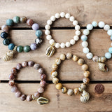 gold dipped sea shell charms on 12mm gemstone bead stretch bracelets