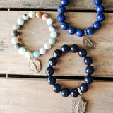 3 St. Mary bead bracelets in shades of blue vintage medals