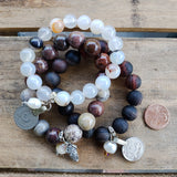 stack of agate 10mm 12mm bead bracelets w 11mm freshwater pearl dangles and belly dancer coins & Mary unitier of knots