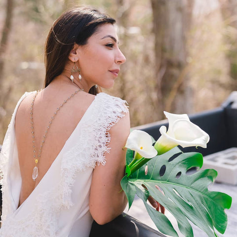 bride wearing necklace PC: Heather Cox Photography