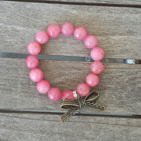 protection bracelet pink jade 10mm round stones vintage eyelet brass bow charm