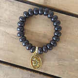 protection bracelet by Marinella jewelry approx 12mm button shaped matte black agate stones quality stretch St Joseph medal brass