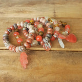 protection bracelets by Marinella stack of cherry quartz in various bead sizes 10mm - 12mm and charms