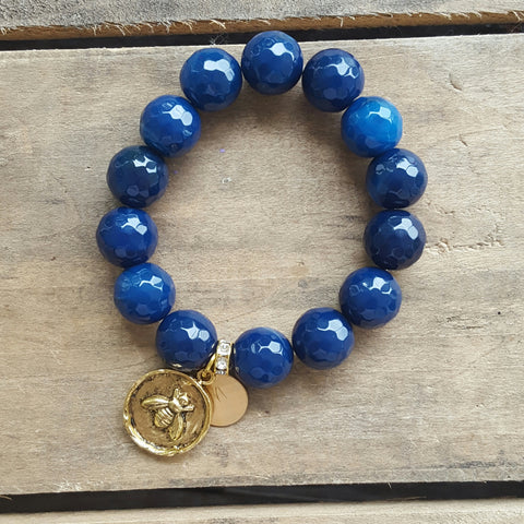 protection bracelet by Marinella cobalt agate beads gold bee charm and stamped M tag