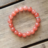 strawberry jade protection stone bracelet w rhinestone closure