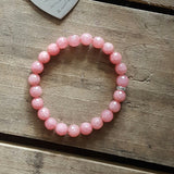 light strawberry jade protection stone bracelet w rhinestone closure