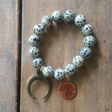 protection bracelet by Marinella jewlery 12mm dalmatian jasper beads brass half moon charm