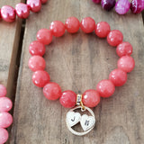 12mm salmon pink faceted beads bracelet w 19mm round brass double hearts charm