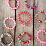 hand stamped brass hearts charm pink bead bracelets collection