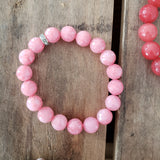 10mm faceted lt. pink jade bead bracelet