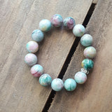 protection bracelet in a swirl of green & pink jade 12mm quality stretch