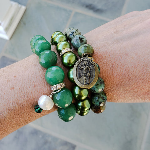 stack of bead bracelets in May's birthstone emerald green color 12mm 14mm