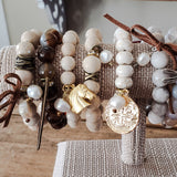 collection of bead bracelets with various charms and 11mm freshwater pearl dangles