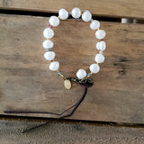 "10mm freshwater round and pearls crystals with 3"" leather tassel 7"" long bracelet"