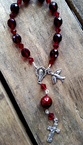 protection bracelets by Marinella one decade garnet crystals chaplet with dove & cross