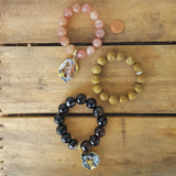 "protection bracelets by Marinella 14mm strawberry quartz 16mm black stripe agate beads 1 1/2"" geode slice charms"