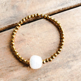 4mm gold hematite beads one centered 14mm fw pearl stretch bracelet