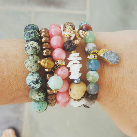 protection bracelets by Marinella Island collection stacked on models wrist