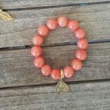 protection bracelet coral jade with gold pewter Buddah charm