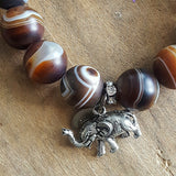 madagascar swirl agate protection bracelet elephant nose up charm and M tag close up