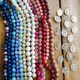 gemstone bead and religious medal options