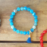 "teal stripe agate 8mm beads with a blue 1/2"" tassel charm bracelet"