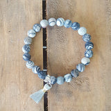 "web agate 8mm beads with a silver 1/2"" tassel charm bracelet"