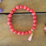 "strawberry jade 8mm beads with a light pink 1/2"" tassel charm bracelet"