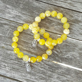 mommy and me protection bracelets pewter pineapple charms yellow agate beads