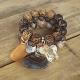 protection bracelets by Marinella jewelry natural stone wood beads stone charms stack