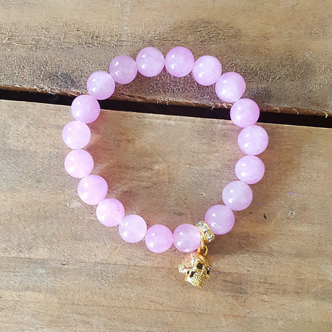 protection bracelet by Marinella 10mm pink faceted jade 12mm gold pewter skull charm