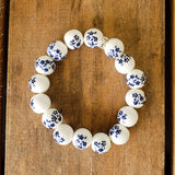 12mm hand painted dark blue daisies on porcelain bead bracelet