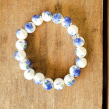 10mm hand painted lt. blue peonies on porcelain bead bracelet