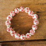 12mm porcelain with hand painted red orange daisy flowers bead bracelet