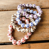 12mm porcelain hand painted floral beads quality stretch bracelets in red, blue, brown, purple