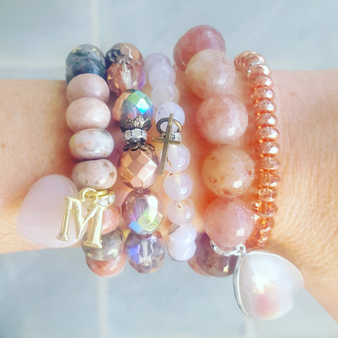 protection bracelets by Marinella rose' collection stacked on models wrist