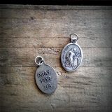 "1"" oval silver oxide St. John of God medal front and back"