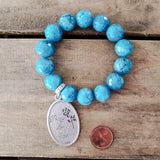 "14mm teal jade beads and 2"" long Our Lady of Guadalupe medal bracelet"