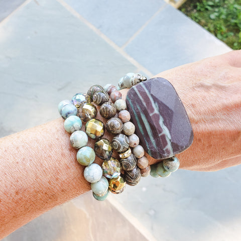 Teal & Tan quality stretch gemstone beads bracelets stack on Marinella's wrist