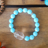 protection bracelet by Marinella 10mm blue opaque beads crystal quartz center