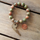 uaknite pink green stone with vintage brass key charm protection bracelet penny