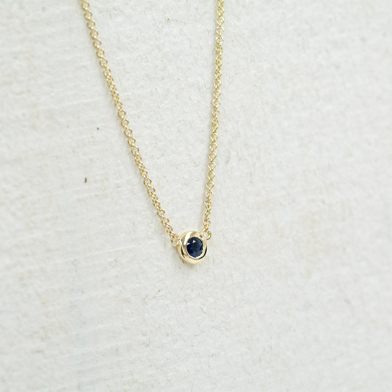 Solitaire Blue Sapphire Necklace Necklace - A Gilded Leaf jewelry