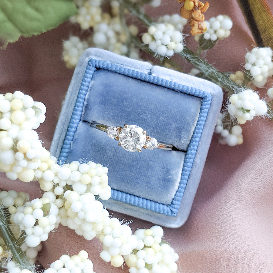 Forever One Round Moissanite and Sapphire Three Stone Engagement Ring