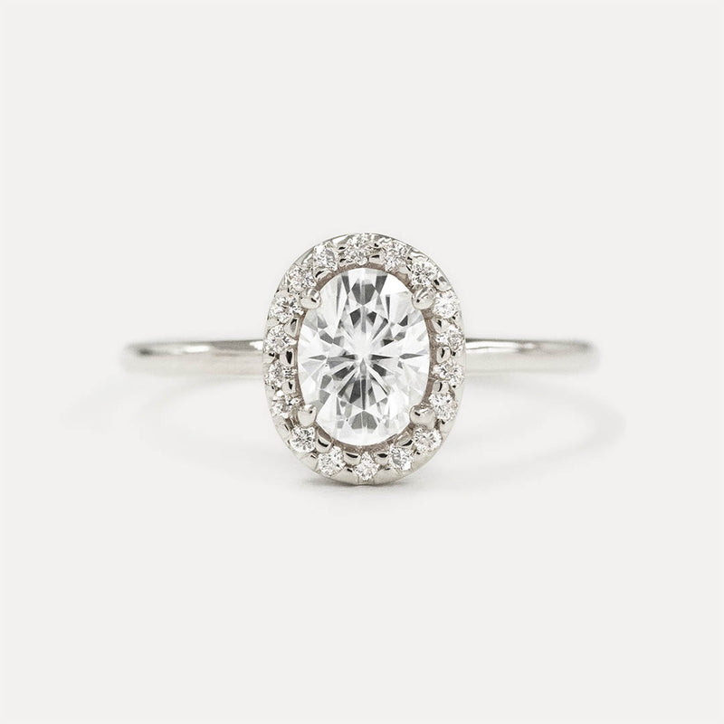 Oval Moissanite and Diamonds Halo Engagement Ring